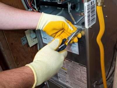 emergency electrician fixing ac unit